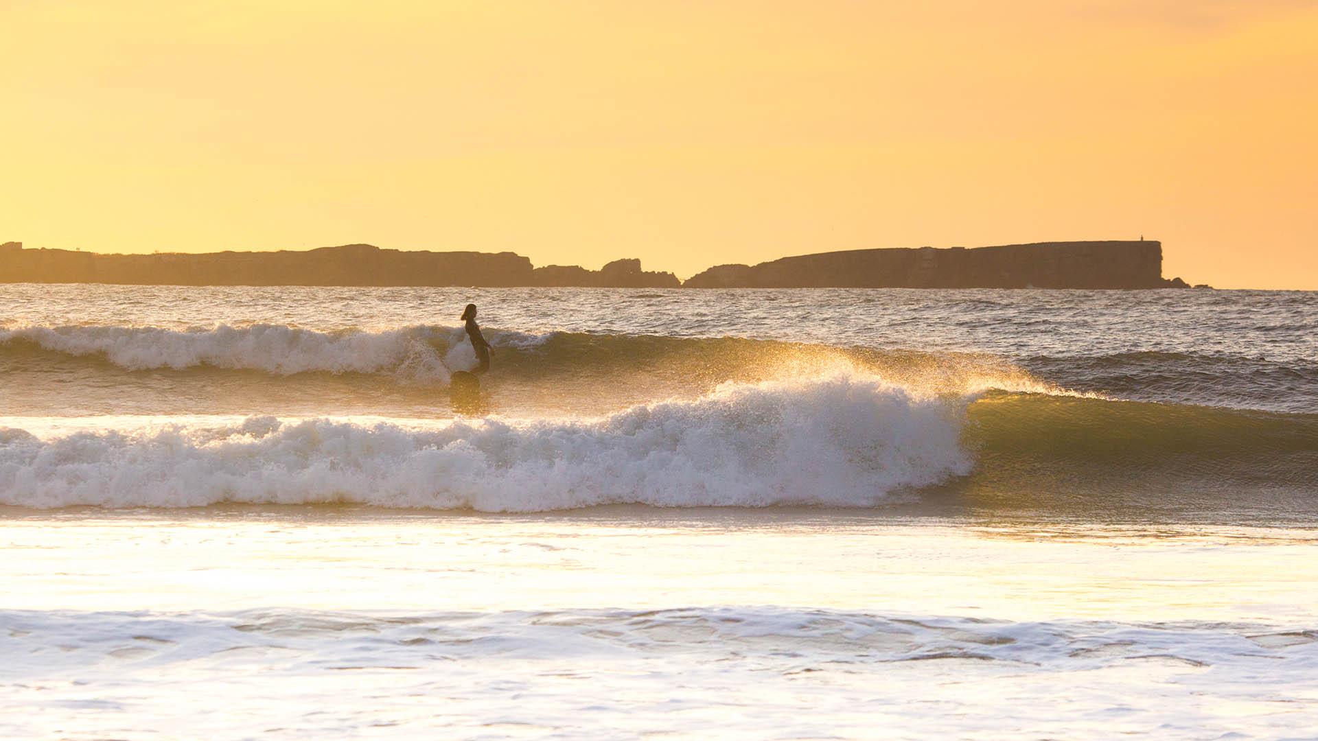 baleal sunset surfer